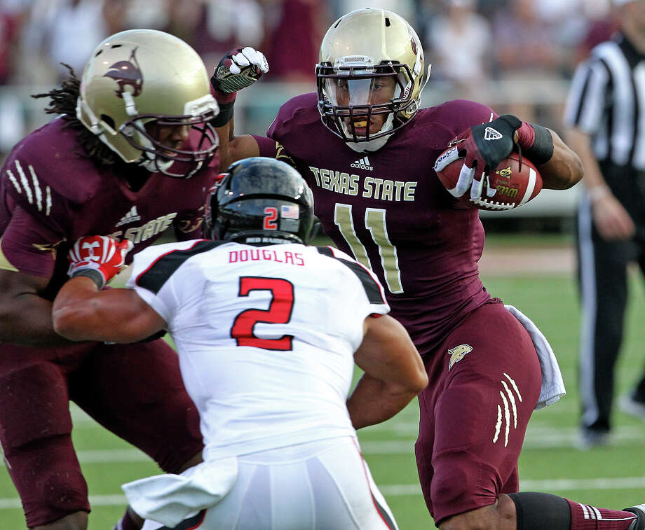 Bobcat receiver Tim Hawkins makes yards on a cut to the sideline as Texas State hosts Texas Tech at Bobcat Stadium on September 8, 2012. Photo: Tom Reel, Express-News / ©2012 San Antono Express-News