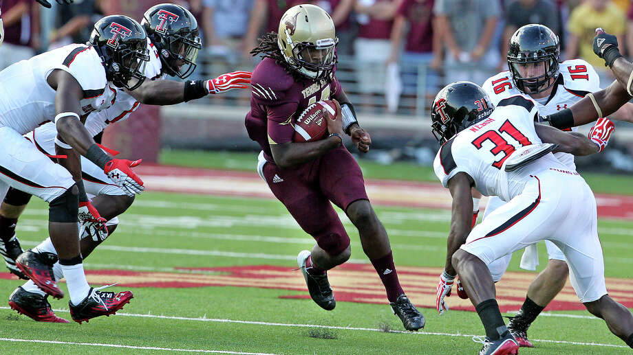 Bobca quarterback Shaun Rutherford is trapped by four Red Raider defenders as Texas State hosts Texas Tech at Bobcat Stadium on September 8, 2012. Photo: Tom Reel, Express-News / ©2012 San Antono Express-News