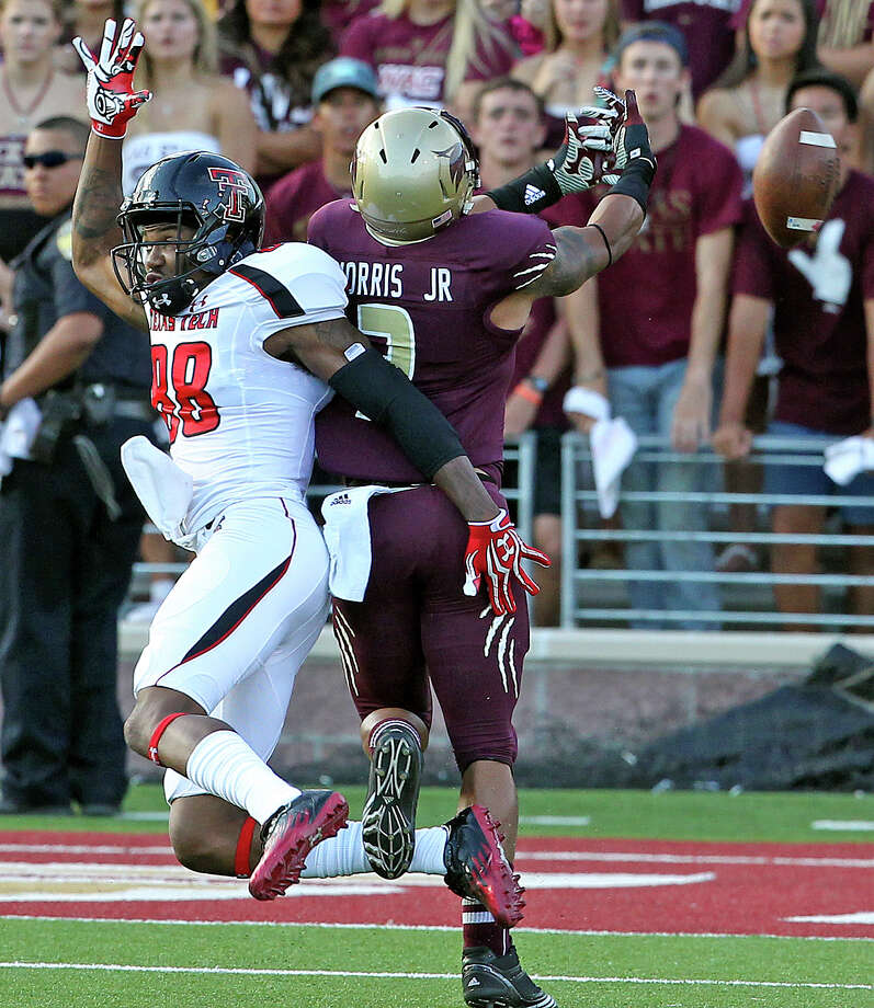 Bobcat cornerback Darryl Morris almost intercepts a long pass intended for Marcus Kennard as Texas State hosts Texas Tech at Bobcat Stadium on September 8, 2012. Photo: Tom Reel, Express-News / ©2012 San Antono Express-News