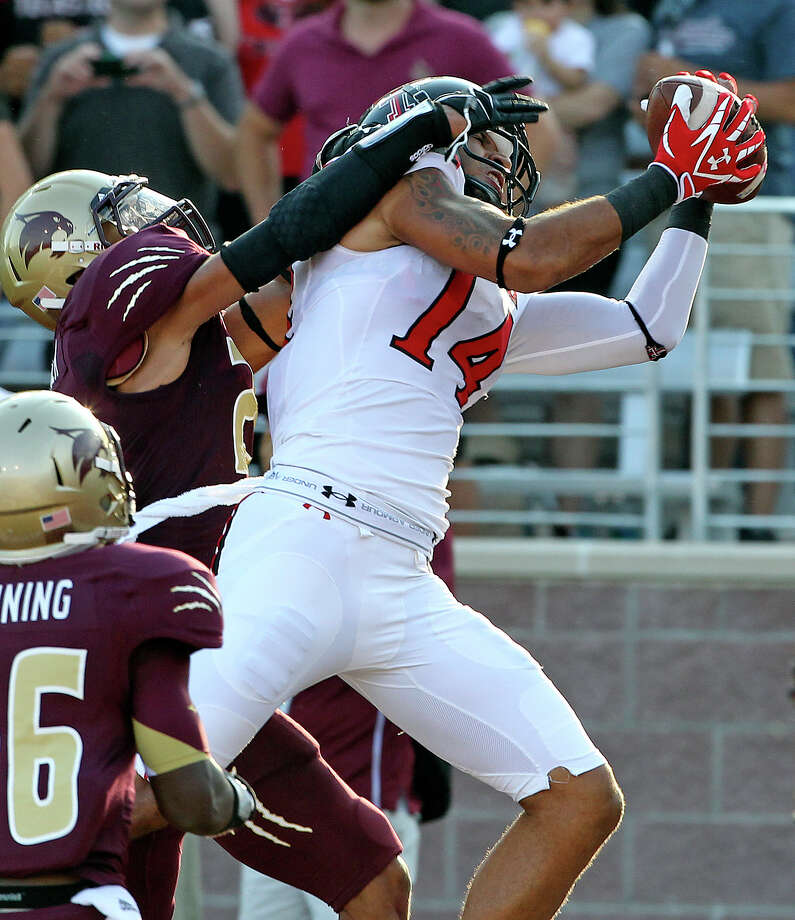 Red Raider Darrin Moore pulls down a touchdown pass behind Craig Mager as Texas State hosts Texas Tech at Bobcat Stadium on September 8, 2012. Photo: Tom Reel, Express-News / ©2012 San Antono Express-News