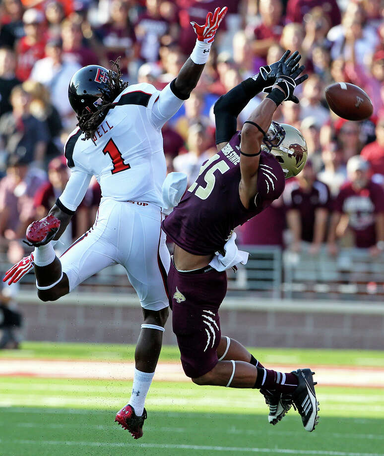 Bobcat defender Craig Mager (25) prevents Javon Bell from making a reception in the first half as Texas State hosts Texas Tech at Bobcat Stadium on September 8, 2012. Photo: Tom Reel, Express-News / ©2012 San Antono Express-News
