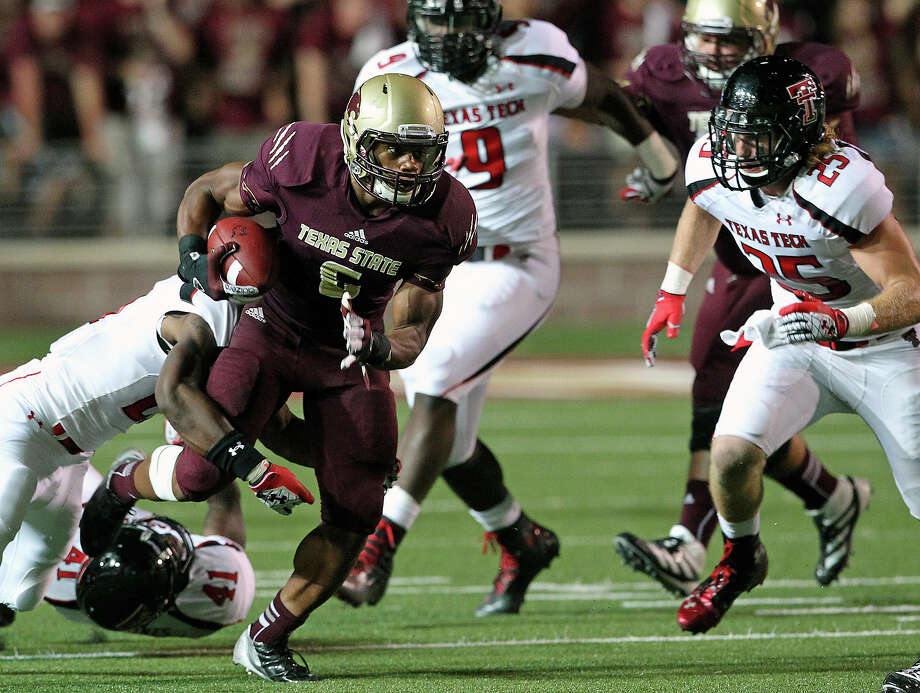 Isaiah Battle picks up some yards for the Bobcats in the second half as Texas State hosts Texas Tech at Bobcat Stadium on September 8, 2012. Photo: Tom Reel, Express-News / ©2012 San Antono Express-News