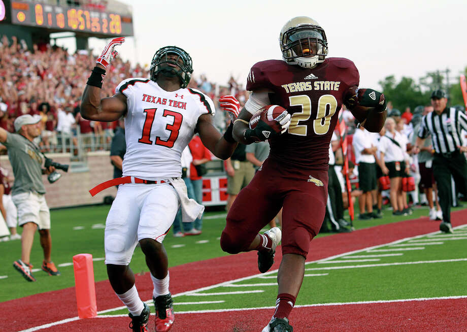 Terrance Franks score the first Bobcat touchdown, beating linebacker Sam Eguavoen on the right as Texas State hosts Texas Tech at Bobcat Stadium on September 8, 2012. Photo: Tom Reel, Express-News / ©2012 San Antono Express-News