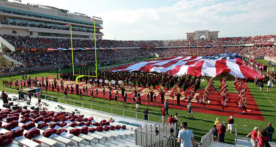 A huge flag covers the field before the start of the game as Texas State hosts Texas Tech at Bobcat Stadium on September 8, 2012. Photo: Tom Reel, Express-News / ©2012 San Antono Express-News