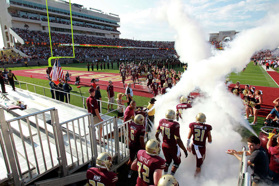 The Bobcats take to the field to open their new stadium as Texas State hosts Texas Tech at Bobcat Stadium on September 8, 2012. Photo: Tom Reel, Express-News / ©2012 San Antono Express-News