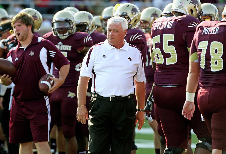 Dennis Franchione watches pre game drills as Texas State hosts Texas Tech at Bobcat Stadium on September 8, 2012. Photo: Tom Reel, Express-News / ©2012 San Antono Express-News