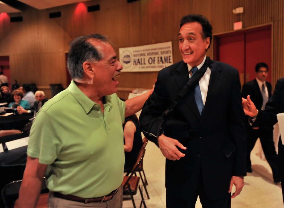 Henry Cisneros talks with Henry Rodriguez prior to the National Hispanic Sports Hall of Fame dinner at the LaVallita Assembly bulding Saturday evening. Photo: Express-News