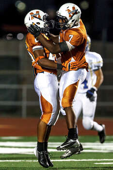 Madison running backs Marquis Warford (right) and Galen McAllister celebrate McAllister's 52-yard touchdown, his second of the night, during their game with Kerrville Tivy at Comalander Stadium on Sept. 8, 2012.  Madison won the game 44-14.  MARVIN PFEIFFER/ mpfeiffer@express-news.net Photo: MARVIN PFEIFFER, Express-News / Express-News 2012