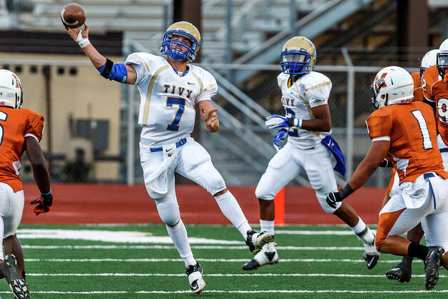Kerville Tivy quarterback Parks McNeil gets off a pass during the first quarter of the Antlers' game with Madison at Comalander Stadium on Sept. 8, 2012. Madison won the game 44-14.   MARVIN PFEIFFER/ mpfeiffer@express-news.net Photo: MARVIN PFEIFFER, Express-News / Express-News 2012