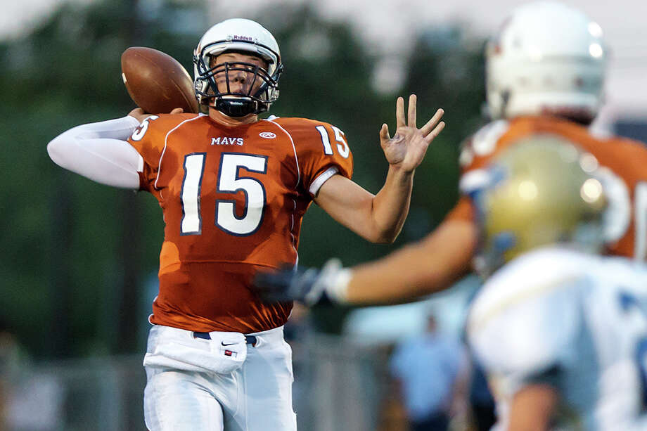 Madison quarterback Cody Ennis hit 16 of 23 passes for 288 yards and four TDs last week in a victory over Roosevelt.  MARVIN PFEIFFER/ mpfeiffer@express-news.net Photo: MARVIN PFEIFFER, Express-News / Express-News 2012