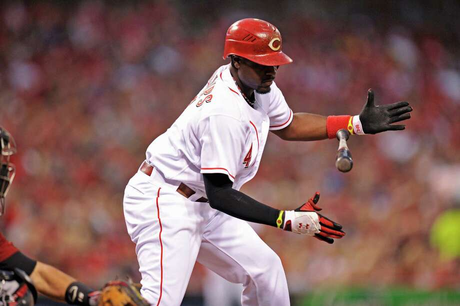 The Reds' Brandon Phillips loses his bat on a checked swing in the third inning. He homered off Astros starter Bud Norris on the next pitch. Photo: Jamie Sabau / 2012 Getty Images