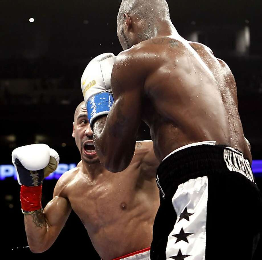 Andre Ward, (left) in tight on Chad Dawson for the WBA/WBC super middleweight title at the Oracle Arena in Oakland, Calif., on Saturday September 08, 2012.  Andre Ward scored a technical knock out in the 10th round against Dawson to retain his title. Photo: Michael Macor, The Chronicle