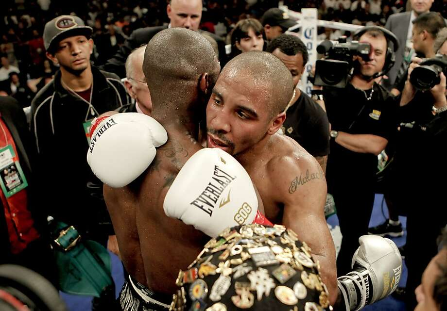 Andre Ward, (right) embraces his opponent Chad Dawson after winning and retaining the WBA/WBC super middleweight title at the Oracle Arena  in Oakland, Calif., on Saturday September 08, 2012.  Andre Ward scored a technical knock out in the 10th round against Dawson. Photo: Michael Macor, The Chronicle