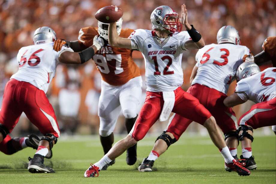 AUSTIN, TX - SEPTEMBER 8: B.R. Holbrook #12 of the University of New Mexico Lobos throws a pass against the University of Texas Longhorns on September 8, 2012 at Darrell K Royal-Texas Memorial Stadium in Austin, Texas. Photo: Cooper Neill, Getty Images / 2012 Getty Images