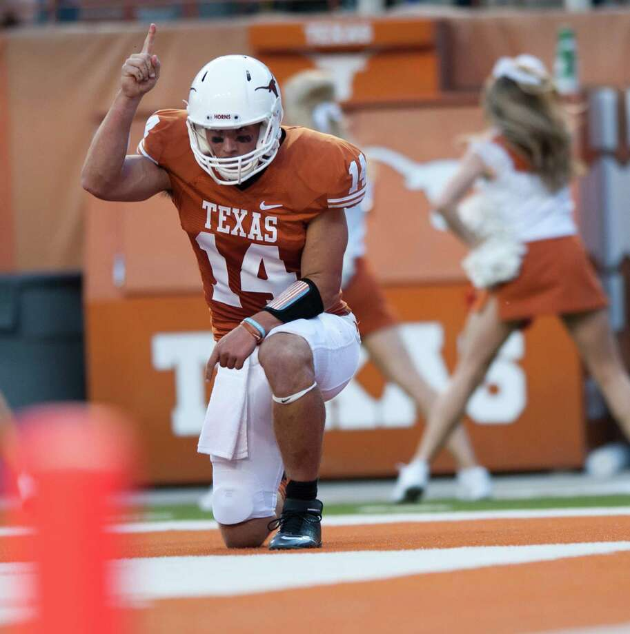 AUSTIN, TX - SEPTEMBER 8: David Ash #14 of the Texas Longhorns scores a touchdown against the University of New Mexico Lobos on September 8, 2012 at Darrell K Royal-Texas Memorial Stadium in Austin, Texas. Photo: Cooper Neill, Getty Images / 2012 Getty Images