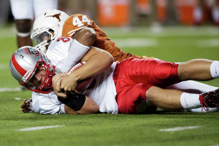 AUSTIN, TX - SEPTEMBER 8: Cole Gautsche #8 of the University of New Mexico Lobos is tackled by Jackson Jeffcoat #44 of the Texas Longhorns on September 8, 2012 at Darrell K Royal-Texas Memorial Stadium in Austin, Texas. Photo: Cooper Neill, Getty Images / 2012 Getty Images