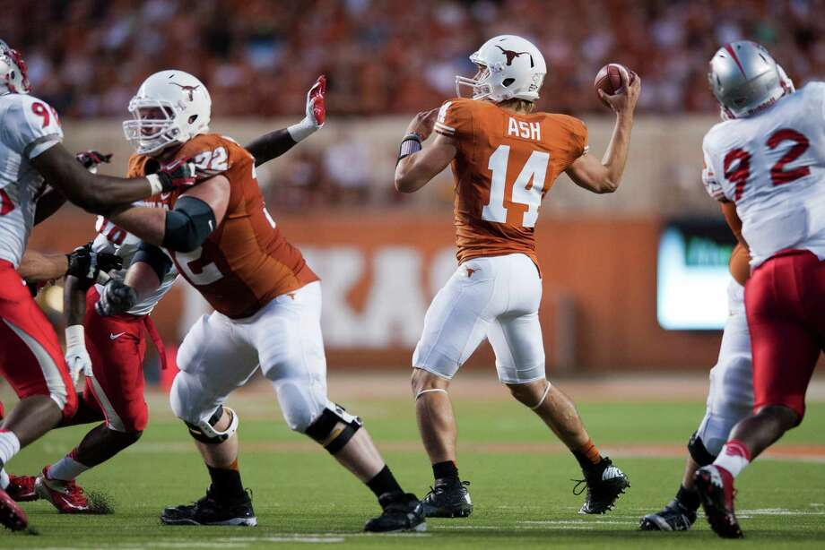 AUSTIN, TX - SEPTEMBER 8: David Ash #14 of the Texas Longhorns throws a pass against the University of New Mexico Lobos on September 8, 2012 at Darrell K Royal-Texas Memorial Stadium in Austin, Texas. Photo: Cooper Neill, Getty Images / 2012 Getty Images