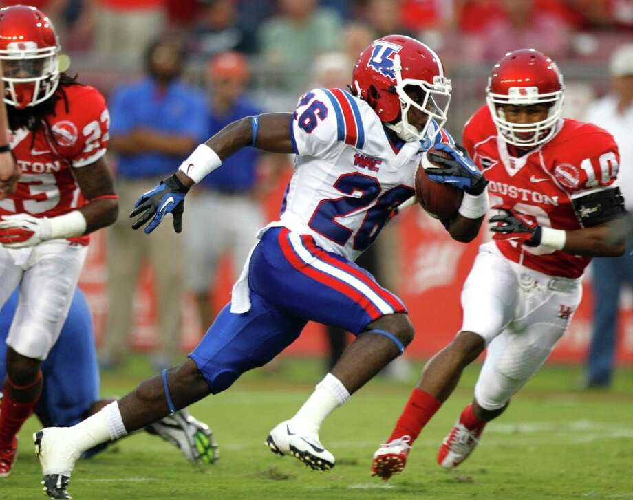 A week after struggling offensively, UH was a step slow on defense Saturday, including Louisiana Tech's Tevin King zipping past Zachary McMillian. Photo: Brett Coomer / © 2012  Houston Chronicle