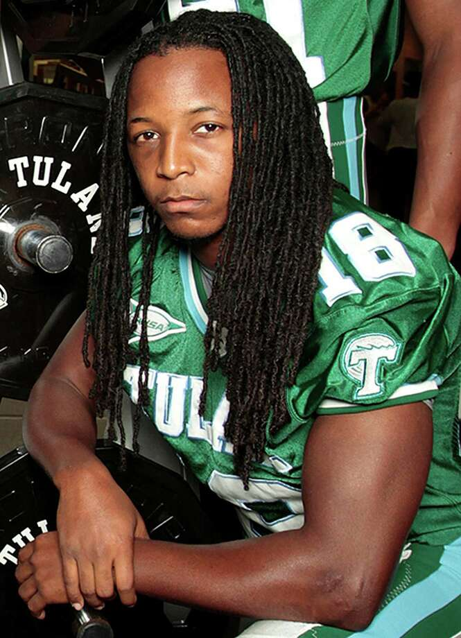 Tulane safety Devon Walker fractured his spine in a head-to-head collision with a teammate during an NCAA college football game against Tulsa, Saturday, Sept. 8, 2012, in Tulsa, Okla., according to the team doctor. (AP Photo/The Times-Picayune, Chris Granger) Photo: Chris Granger, MBR / The Times-Picayune