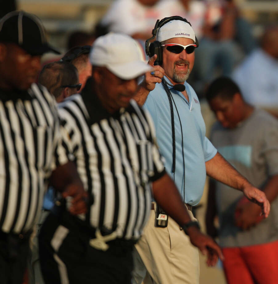 Madison head coach Pat Reinecke yells at officials during the first half of a high school football game against Bush High School, Saturday, September 8, 2012, at Mercer Stadium in Sugar Land, TX. Photo: Eric Christian Smith, For The Chronicle