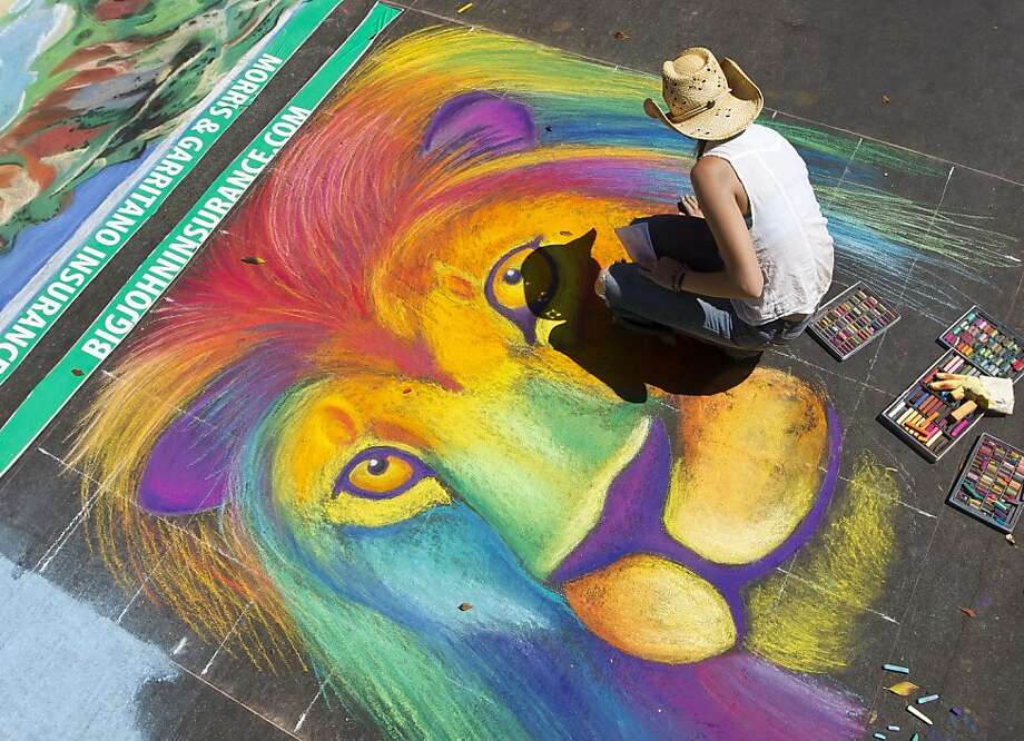 Rachel Ashley,from Templeton, works on a lion drawing at the I Madonnari Italian Street Painting Festival at the Madonna Plaza in San Luis Obispo, Calif., on Saturday, September 8, 2012. (AP Photo/The Tribune, Jayson Mellom) Photo: Jayson Mellom, Associated Press