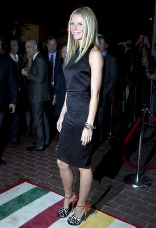 "Gwyneth Paltrow poses on the red carpet at the gala for the new movie ""Thanks For Sharing"" during the 2012 Toronto International Film Festival in Toronto on Saturday, Sept. 8, 2012. (AP)"