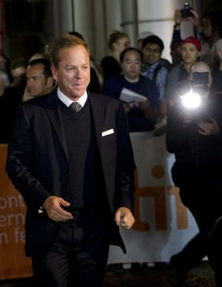 "Actor Kiefer Sutherland poses for a photograph on the red carpet at the gala for the new movie "" The Reluctant Fundamentalist."" (AP)"