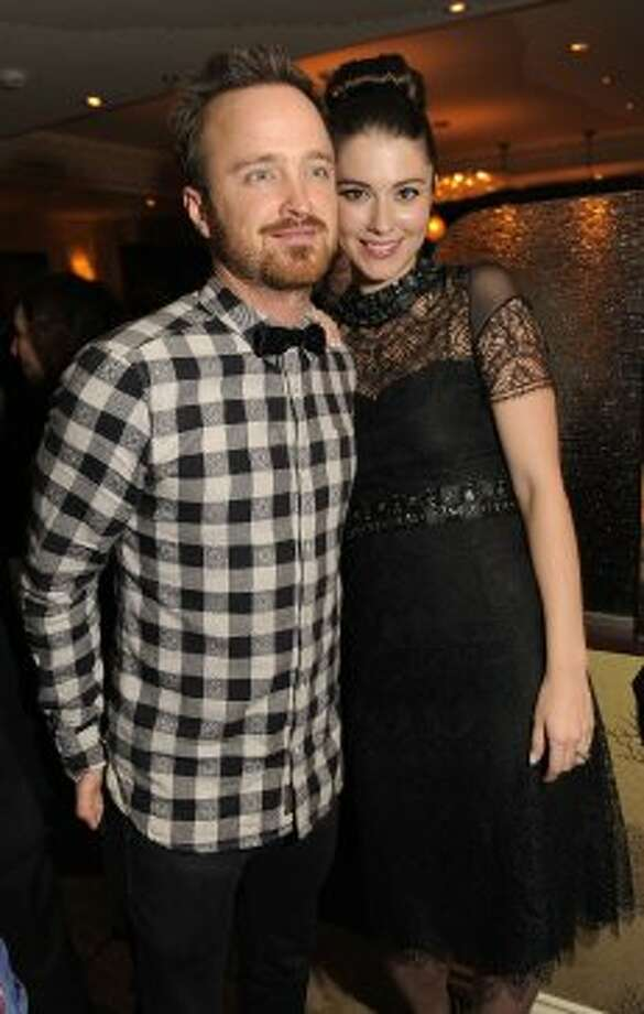 "Aaron Paul, left, and Mary Elizabeth Winstead, cast members in the film ""Smashed,"" pose together at the Sony Pictures Classics party. (CHRIS PIZZELLO/INVISION/AP)"