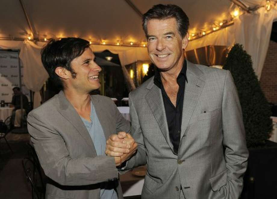 Mexican actor Gael Garcia Bernal, left, mingles with actor Pierce Brosnan at the Sony Pictures Classics party. (CHRIS PIZZELLO/INVISION/AP)