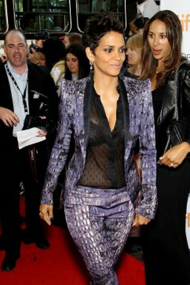 "This image released by Starpix shows actress Halle Berry arriving at the premiere of ""Cloud Atlas."" (ASSOCIATED PRESS)"