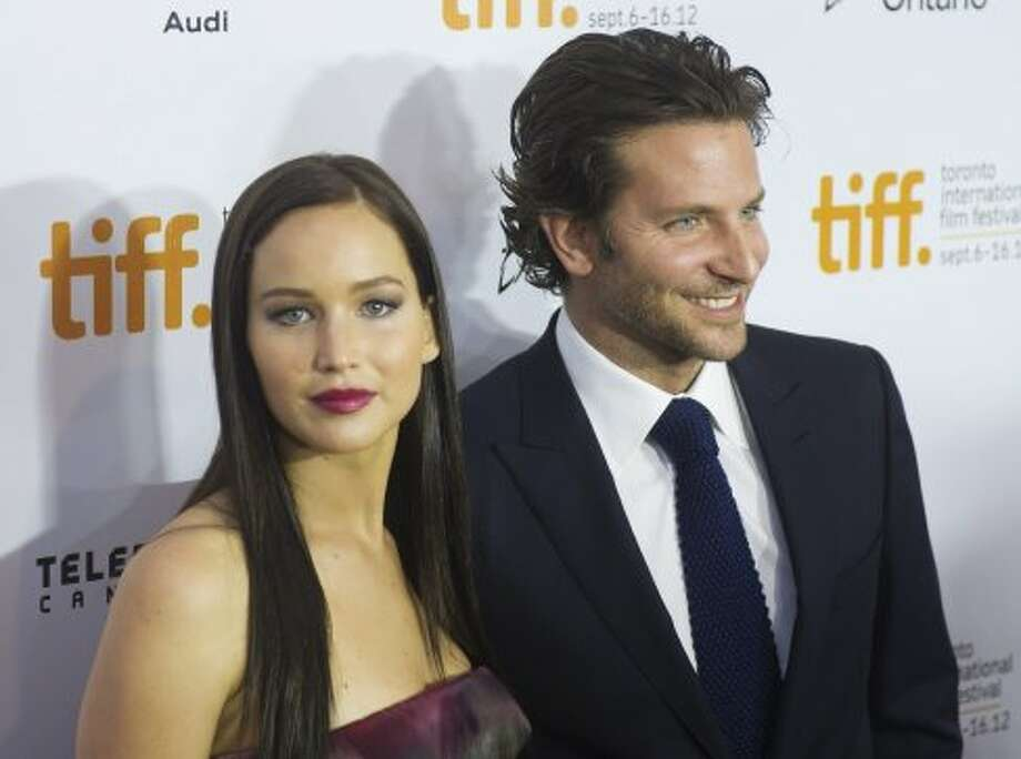 "Actress Jennifer Lawrence, left, and actor Bradley Cooper pose for a photograph on the red carpet at the gala for the new movie ""Sliver Linings Playbook."" (ASSOCIATED PRESS)"