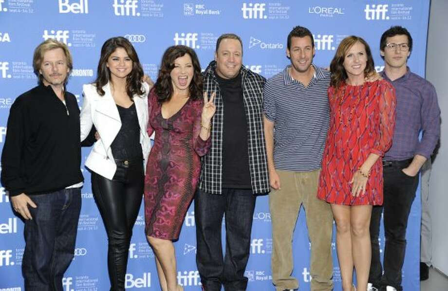 "Cast members, from left, actor David Spade, actress Selena Gomez, actress Fran Drescher, actor Kevin James, actor Adam Sandler, actress Molly Shannon, and actor Andy Samberg participate in a photocall and press conference for the film ""Hotel Transylvania"" at TIFF Bell Lightbox. (EVAN AGOSTINI /INVISION/AP)"