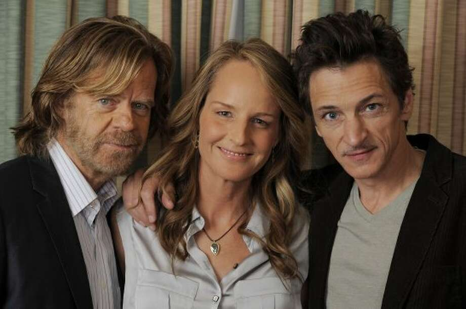 "William H. Macy, left, Helen Hunt, center, and John Hawkes, cast members in ""The Sessions,"" pose together for a portrait. (CHRIS PIZZELLO/INVISION/AP)"