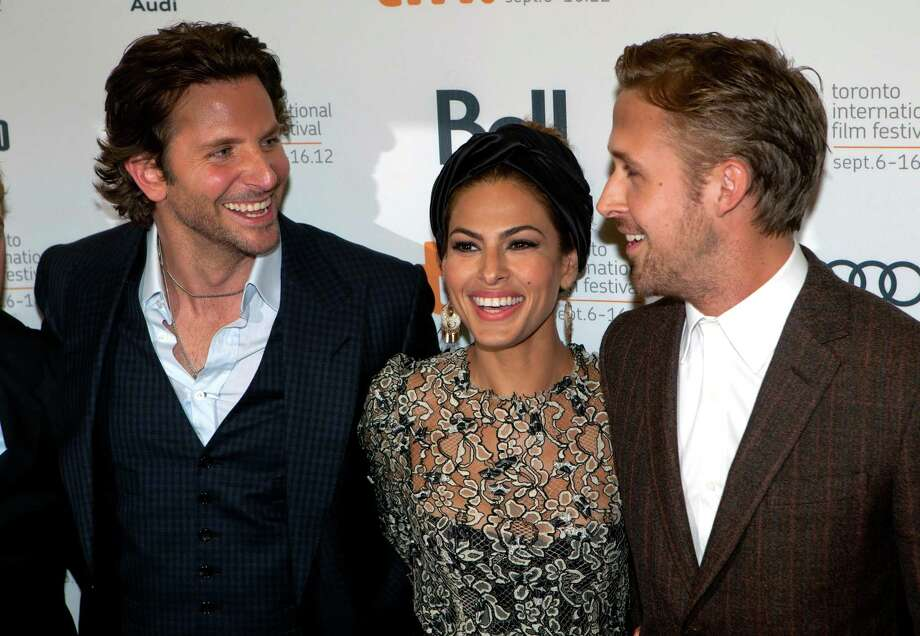 "Bradley Cooper (left), Eva Mendes and Ryan Gosling (right) share a laugh on the red carpet at the gala for the new movie ""The Place Beyond the Pines."" Photo: AP"