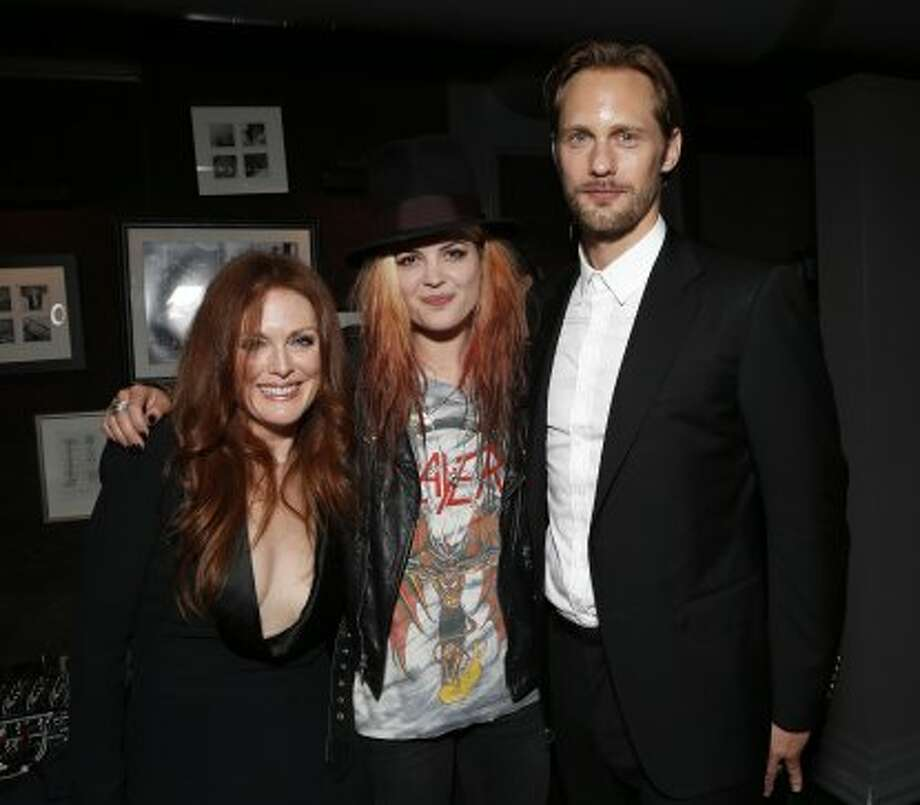 "Julianne Moore, Alison Mosshart of The Kills and Alexander Skarsgard attend the ""What Maisie Knew"" After Party at Storys in Toronto on Friday, Sept 7, 2012. (TODD WILLIAMSON/INVISION/AP)"