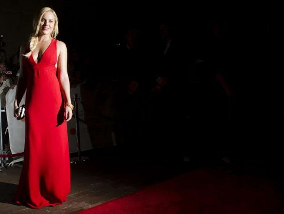 "Actress Abbie Cornish poses on the red carpet at the gala for the new movie ""Seven Psychopaths."" (ASSOCIATED PRESS)"