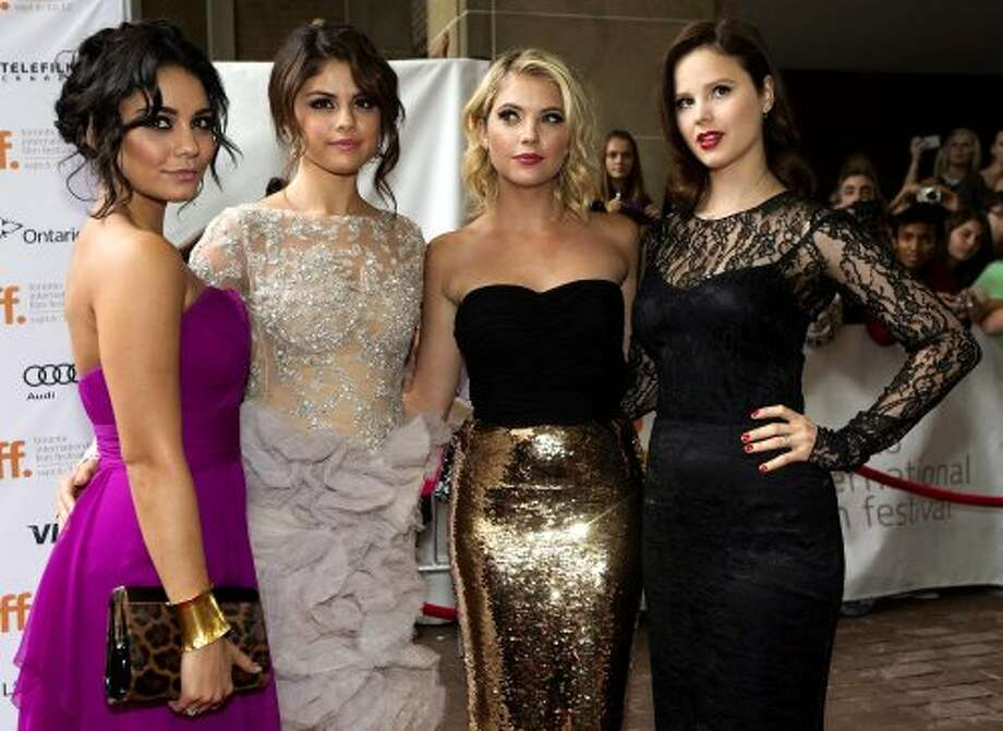 "Actor Vanessa Hudgens, left, poses for a photo with co-stars, from second left,  Selena Gomez, Ashley Benson, and Rachel Korine during a red carpet for the movie ""Spring Breakers."" (ASSOCIATED PRESS)"