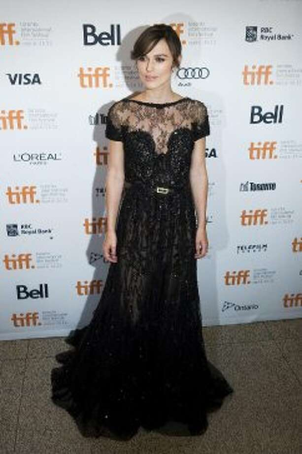 """Actress Keira Knightley poses for a photo on the red carpet at the Elgin Theatre for the film """"Anna Karenina."""" (ASSOCIATED PRESS)"""