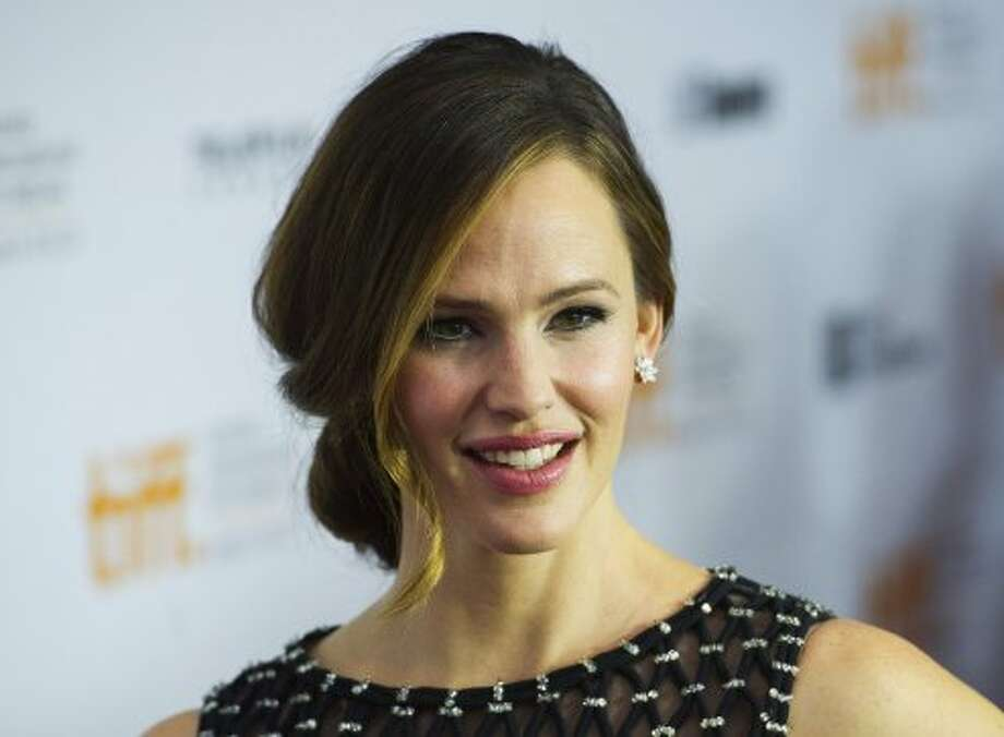 "Actress Jennifer Garner poses for a photograph on the red carpet at the gala for the movie ""Argo."" (ASSOCIATED PRESS)"