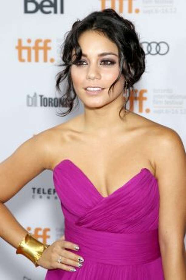 "In this image released by Starpix, actress Vanessa Hudgens poses at the premiere of ""Spring Breakers."" (ASSOCIATED PRESS)"