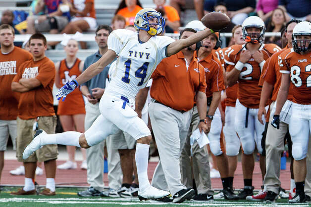Kerrville Tivy wide receiverTyler Ahrens tries to make a one-handed catch during the Antlers' first offensive drive in their game with Madison at Comalander Stadium on Sept. 8, 2012.  MARVIN PFEIFFER/ mpfeiffer@express-news.net Photo: MARVIN PFEIFFER, Express-News / Express-News 2012