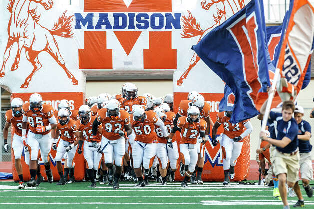 The Madison Mavericks take the field prior to their game with Kerrville Tivy at Comalander Stadium on Sept. 8, 2012.  MARVIN PFEIFFER/ mpfeiffer@express-news.net Photo: MARVIN PFEIFFER, Express-News / Express-News 2012