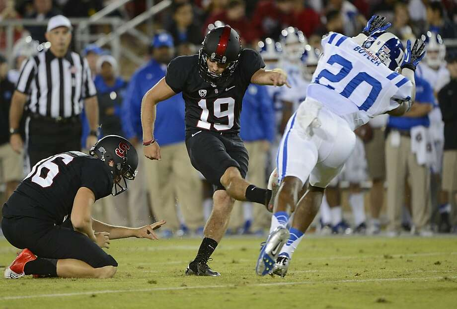PALO ALTO, CA - SEPTEMBER 08:  Jordan Williamson #19 of the Stanford Cardinals kicks a thirty two yard field goal past Lee Butler #20 of the Duke Blue Devils during the first quarter of an NCAA football game at Stanford Stadium on September 8, 2012 in Palo Alto, California.  (Photo by Thearon W. Henderson/Getty Images) Photo: Thearon W. Henderson, Getty Images