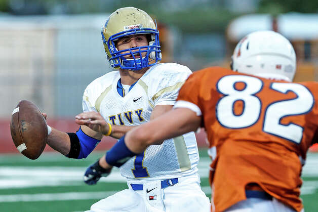Madison's Mitchell Brown (fright) closes in on Kerrville Tivy quarterback Parks McNeil as he looks for a receiver during their game at Comalander Stadium on Sept. 8, 2012. Madison won the game 44-14.  MARVIN PFEIFFER/ mpfeiffer@express-news.net Photo: MARVIN PFEIFFER, Express-News / Express-News 2012