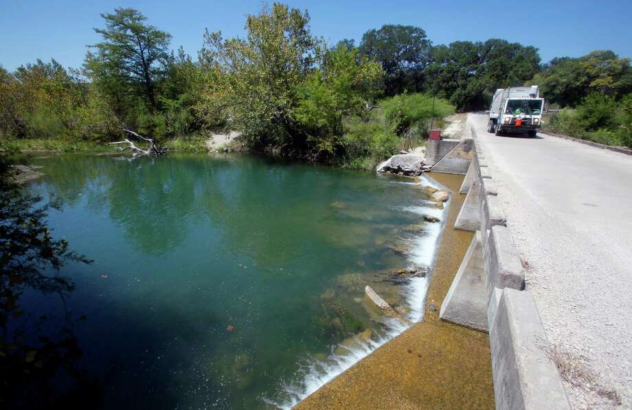 The Medina River is seen Thursday Sept. 6, 2012 as it flows under County Road 2615 north of Castroville. The outlets on Medina Dam were closed by the BMA on Wednesday to conserve water in the lake which stood over 64 feet below normal pool Thursday, according to the Texas Water Development Board's website, making the reservoir only 13.41 percent full. Photo: William Luther, San Antonio Express-News / © 2012 San Antonio Express-News
