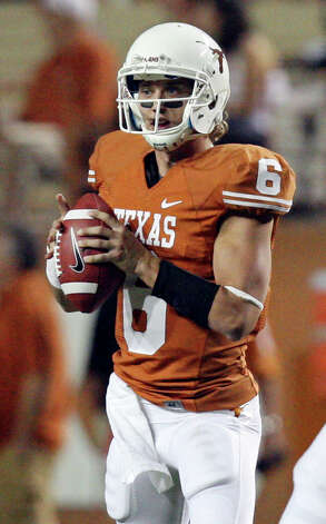 Texas Longhorns' Case McCoy looks to pass against the New Mexico Lobos during second half action Saturday Sept. 8, 2012 at Texas Memorial Stadium in Austin, Tx. The Longhorns won 45-0. Photo: Edward A. Ornelas, Express-News / © 2012 San Antonio Express-News