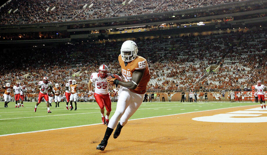 Texas Longhorns' M.J. McFarland runs through the end zone after catching a pass for touchdown against the New Mexico Lobos during second half action Saturday Sept. 8, 2012 at Texas Memorial Stadium in Austin, Tx. The Longhorns won 45-0. Photo: Edward A. Ornelas, Express-News / © 2012 San Antonio Express-News