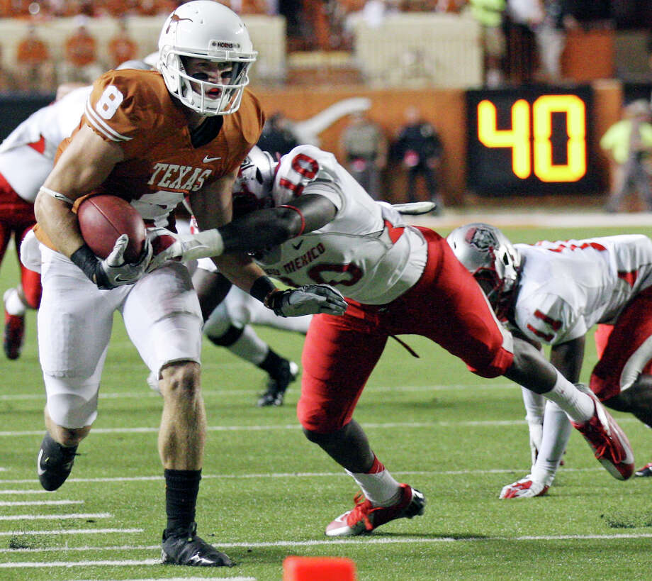 Texas Longhorns' Jaxon Shipley looks for room around New Mexico Lobos' Rashad Rainey during second half action Saturday Sept. 8, 2012 at Texas Memorial Stadium in Austin, Tx. The Longhorns won 45-0. Photo: Edward A. Ornelas, Express-News / © 2012 San Antonio Express-News
