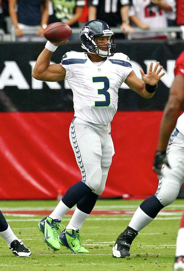 Seattle Seahawks quarterback Russell Wilson (3) looks to pass during the first half of an NFL football game against the Arizona Cardinals, Sunday, Sept. 9, 2012,in Glendale, Ariz. Photo: AP