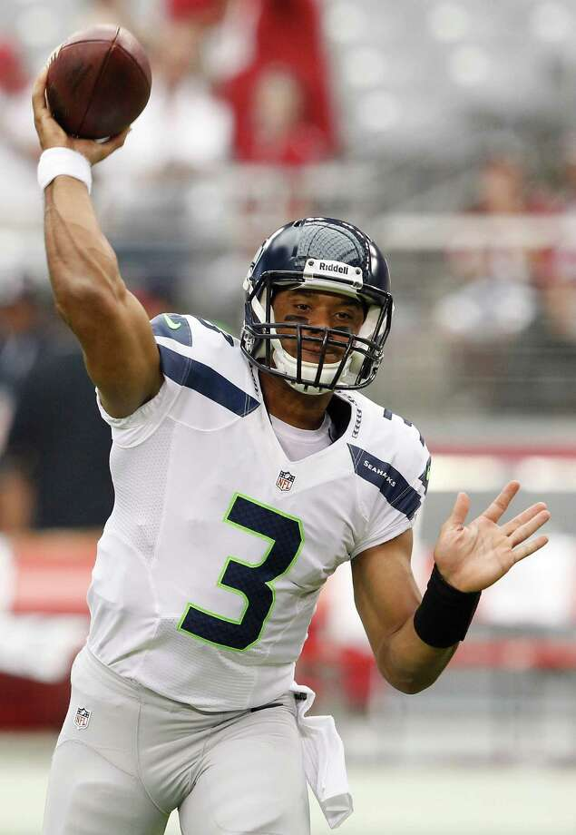 Seattle Seahawks' Russell Wilson warms up prior to an NFL football game against the Arizona Cardinals Sunday, Sept. 9, 2012, in Glendale, Ariz. Photo: AP